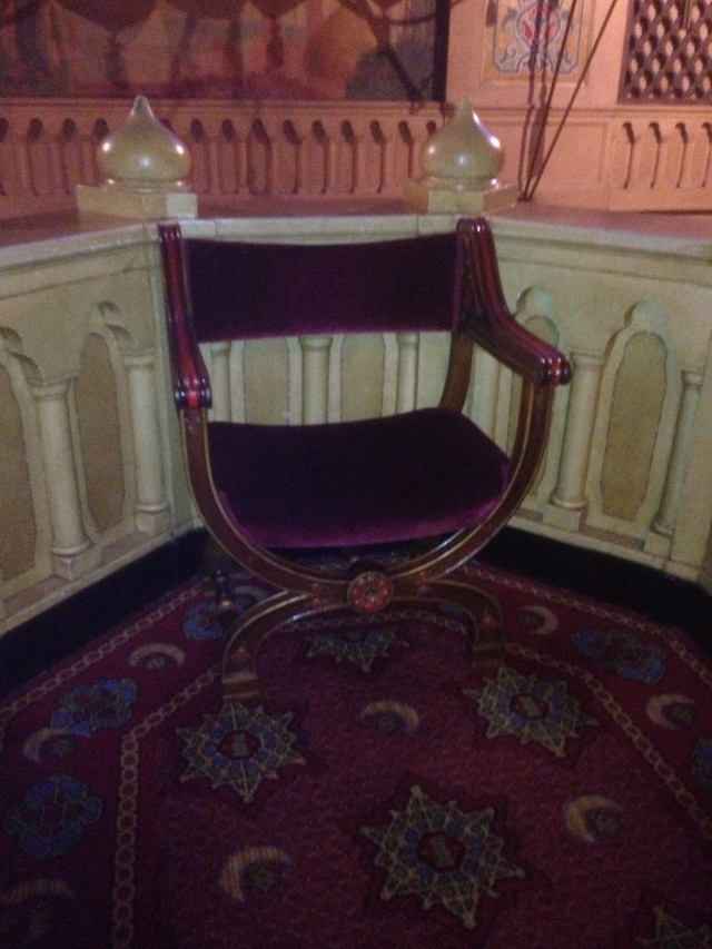 LOVE this chair! Look at the details on the walls, finials and of course the carpet has the logo again.....